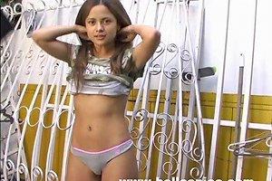 Cute Petite Teen Is Taking Off Her Tee