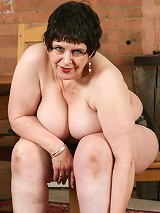 Cute granny gets a deep one between her fat hips