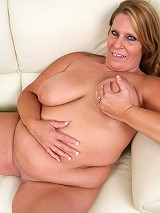 Mature BBW Leighann spreading her fat pussy lips to take cock pounding from a horny guy