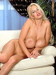 Busty MILF Rebecca bares it all