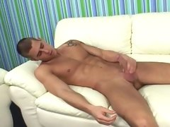 Tatooed guy watch porn on tv and play with his dick in here