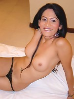 Asian tranny posing naked on bed