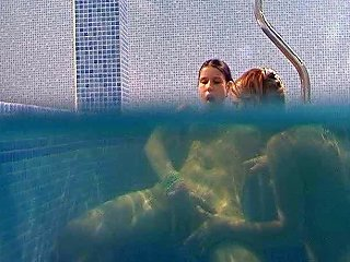 Seductive Brunette Lesbians Tickle Their Snatches Under Water In Pool