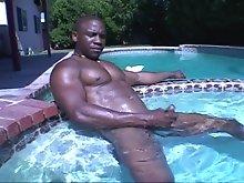 Well-built black hunk JR Langdon masturbating in a nice pool