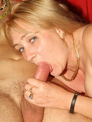 Horny mature blonde Eve guzzling a fat cock before she jumps on top of it and rides it live