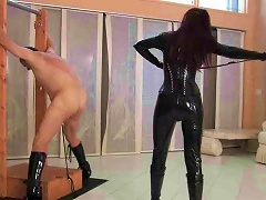 Gal In Latex Catsuit Whips Her Man Hard