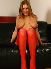 Hot blonde with huge tits spreads stockinged legs
