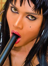 Shemale mistress in black-n-...
