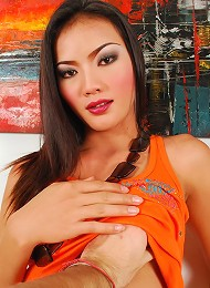 Petite ladyboy strips for the camera