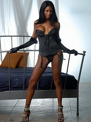 Black tranny shows her huge boobs and ass